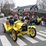 A yellow car on parade