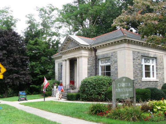 A patron entering the small and historic Chester Public Library (Photo by Jerome Wilson)