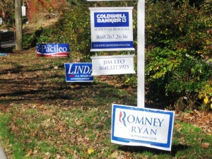 This Republican sign poster wants to sell his house as well as his candidates