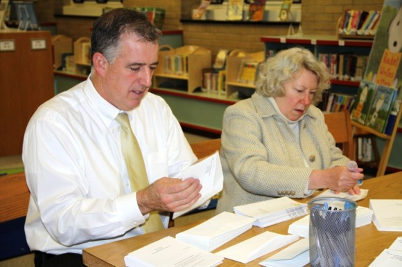 EES Principal Scott Jeffrey and EES Assistant Principal Deborah O'Donnell help stuff envelopes for the EESF annual app
