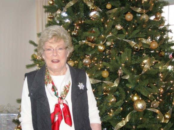 Essex Meadows resident Jean Ryan by the entrance Christmas Tree at the Meadows