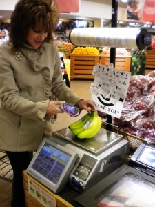 Third step: For loose produce, she weighed it. The scale spit out a receipt with a barcode. She shot it with the Scan It.