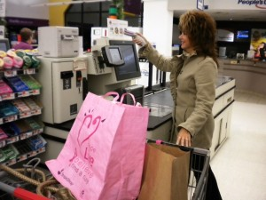 "Final step: At the register, she shot a ""target."" This told the computer she was done. It showed her every item and the total cost. She paid with her card. Then out she went in jig time."