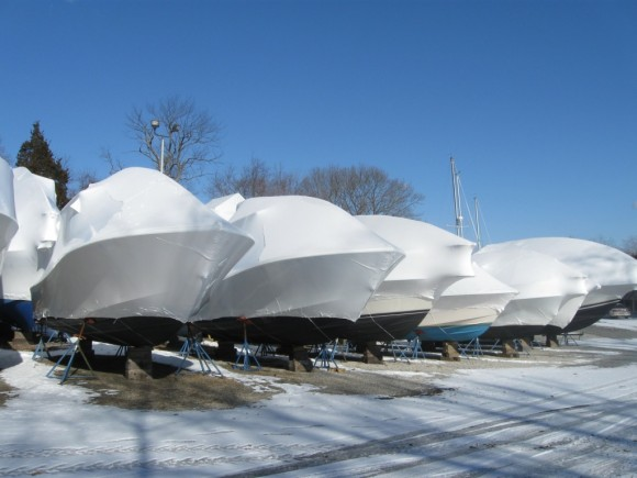 A row of shrink wrapped boats at Island Cove Marina in Old Saybrook