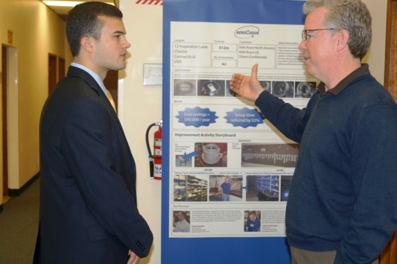 Sen. Art Linares (left) listens to AeroCision CEO Andrew Gibson during a Feb. 27 tour of the Chester-based manufacturer.