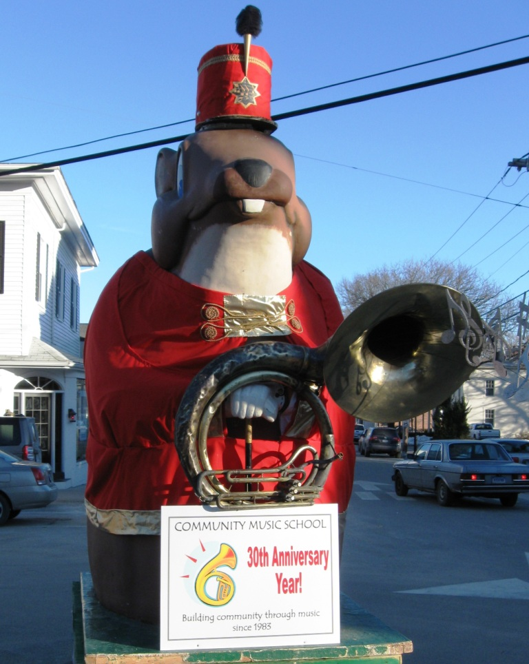 Essex Ed stands guard at the top of Main Street in Essex dressed as The Music Man in honor of the Community Music School's 30th Anniversary.