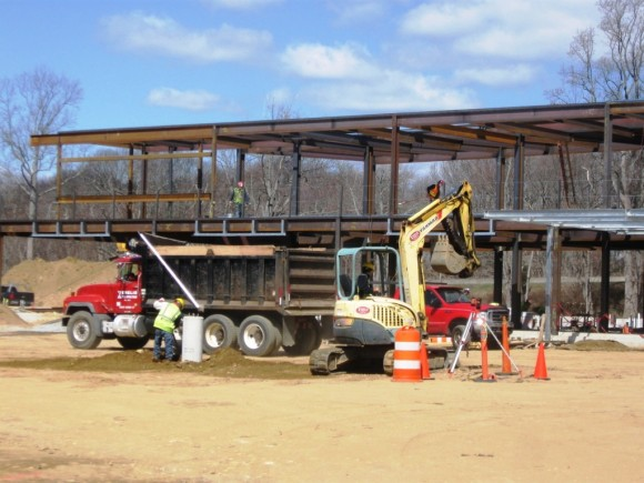 Construction workers busy at Flat Rock Place site, near Exit 65 of I-95