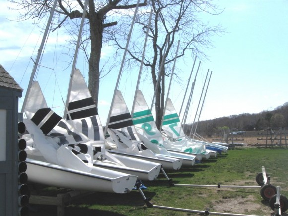 Six rigged sailboats are ready for the afternoon races