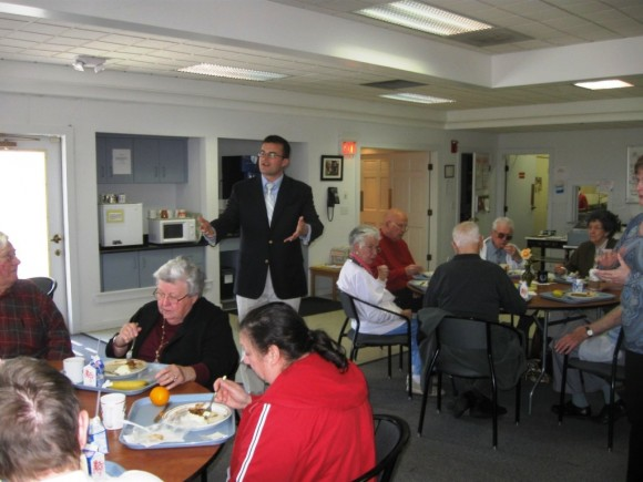 Senator Linares extends a greeting at lunch for seniors in Old Saybrook
