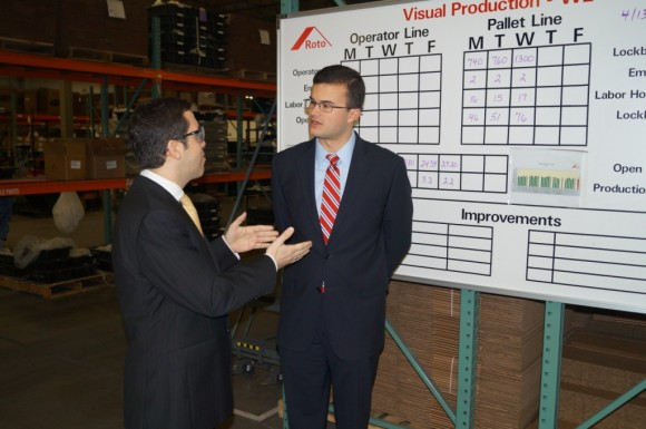 Roto-Frank President and CEO Chris Dimou (left) and Sen. Art Linares (right) chat during Linares' April 11 tour of the Chester-based manufacturer.