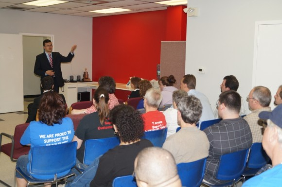 Sen. Art Linares speaks with Roto-Frank employees during his April 11 tour of the Chester-based manufacturer.