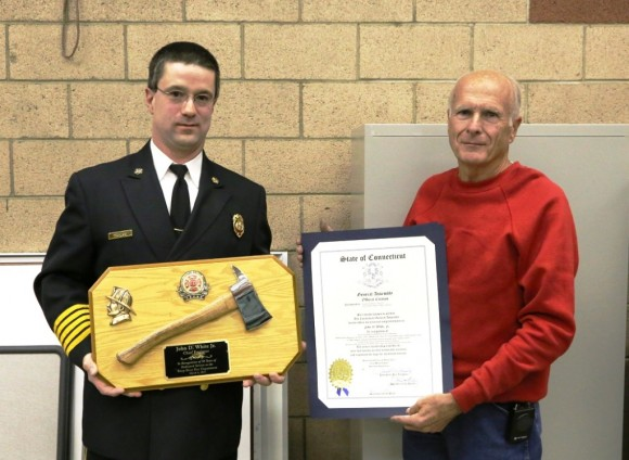 Fire Chief Tim Lee presents Chief Engineer Jack White with a plaque honoring his 50 years of service to the Deep River Fire Department.