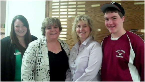 In the photo, L-R:  Calley Beckwith and Denise Learned of Camp Hazen YMCA, Carol Jones and her son, Peter, from Valley Baseball Boosters.