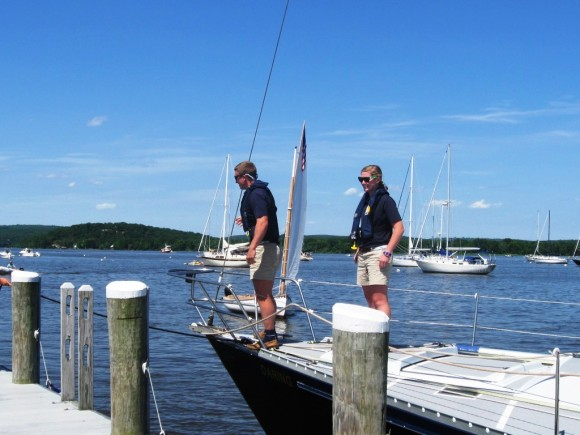 And pulls the sailboat to the dock
