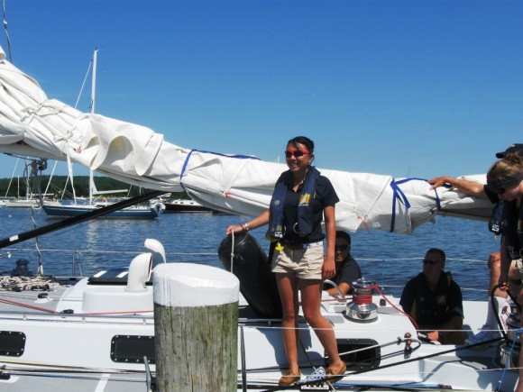 A midshipman takes out a bumper to protect the boat's hull