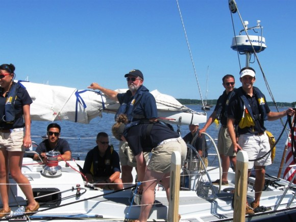 The Daring's Skipper (center) with seven of his crew