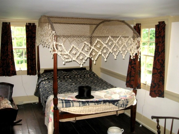 Old four poster bed, note the chamber pot