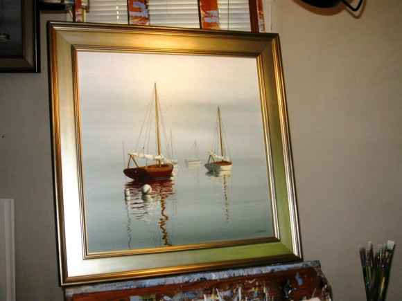 A typical Sabol painting of a sailboats at anchor with reflections quivering on the water