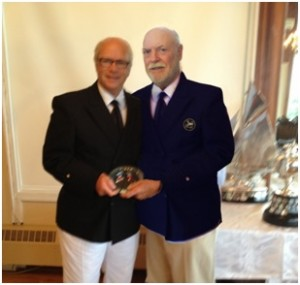 Commodore George Archibald of the Royal Nova Scotia Yacht Squadron at the award ceremony with Harry Bird
