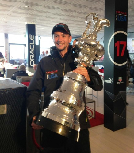 Essex resident Jason Sanstrom holding the American's Cup after the race