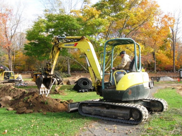Excavating a new drainage pipe on the new playground