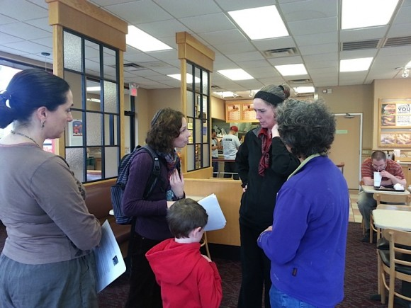 Rabbi Goldenberg, Ziv Goldenberg, Jeannette Ickovics and Melinda Alcosser deliver letters to manager of Wendy's in Guilford