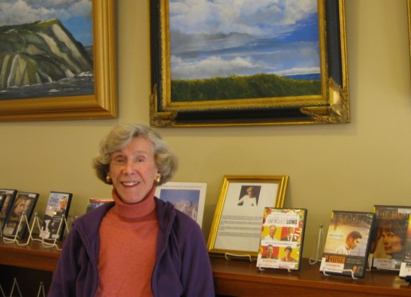 Luisa Kreis Whiting displaying her paintings at the Essex Library