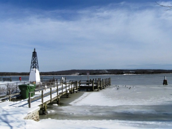 Essex view of Connecticut River, frozen along the shore, flowing in the middle
