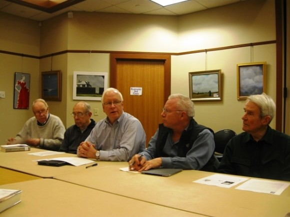 Library Director Richard Conroy (center) chairing an American History Book Club meeting