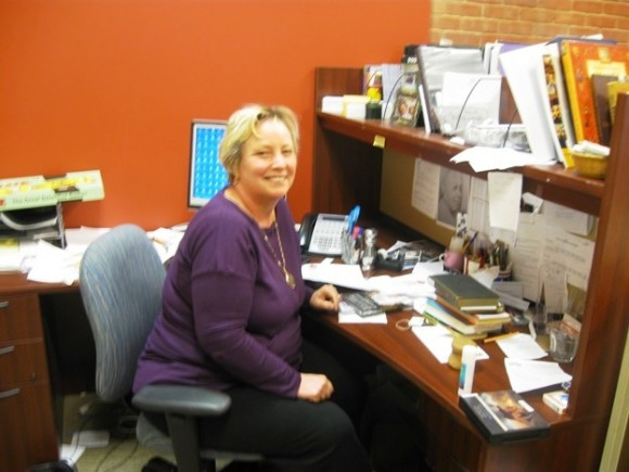 Programming Librarian Jenny Trip, who leads two book clubs and has a host of other duties at the Essex Library