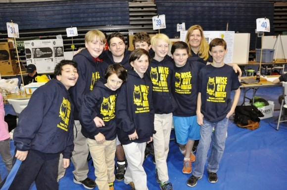 Members of The Country School's Wise Guys Robotics Team at the First Lego League State Championship in December. Pictured, front row, left to right, are: Andre Salkin, Gordie Croce, Robbie Cozean, Ben Iglehart, Aidan Chiaia, and Joseph Coyne. Back row, left to right, are Nate Iglehart, Liam Ber, Emmett Tolis, and Coach Heather Edgecumbe. Missing from the photo is Sarah Platt.