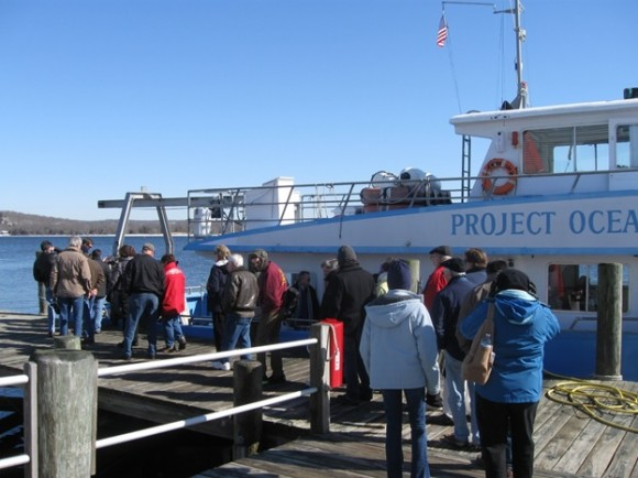 Eagle Watch passengers climb on board Enviro-lab III for the cruise