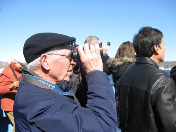 Viewing the bald eagles with binoculars on the front deck of the boat