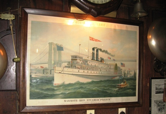 Portrait of a sidewinder steamboat after passing under Brooklyn Bridge