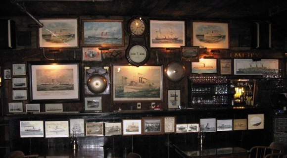 A surfeit of steamboat portraits in the main dining room of Griswold Inn