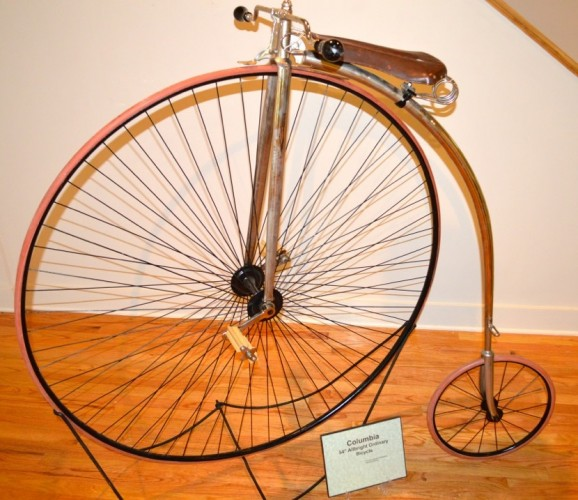 "The Columbia Allbright ""ordinary"" or high-wheeler bicycle, owned by the CT Historical Society, was made in Hartford in the late 19th century. At 54 inches tall, it sparks one's imagination about how anyone could get on it to ride through the town. It can be seen at the Chester Museum at The Mill through the summer."