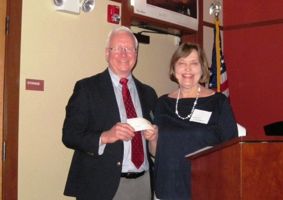Wendy Madsen, President of the Friends of Essex Library, presents Richard Conroy, Library Director, with the Friends' annual donation on June 5, 2014.