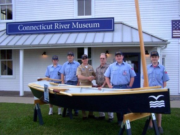 Commodore Marshall Parsons of the Sea Scouts and Steve Tagliatela of Saybrook Point Inn & Marina shake hands to commemorate the Saybrook Point Inn & Marina's sponsorship. The sponsorship will allow several Sea Scouts to take part in the Connecticut River Museum's public Boat Building Workshop to be held in August. From left to right: Reggie Walden of Old Saybrook, Isaac Doggart of Niantic, Commodore Marshall Parson, Steve Taglietela, Daniel Puttre of Old Saybrook and Cameron Fogg of Old Saybrook.