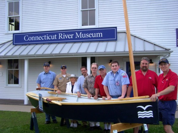 The Sea Scouts gathered at the Connecticut River Museum with Steve Tagliatela, Chris Dobbs and Boat Building Volunteers to celebrate the sponsorship. The Scouts will be one of the groups that take part in the public Boat Building Workshop held at the Museum in August. Left to right: Isaac Doggart of Niantic, Commodore Marshall Parsons, Museum Director Chris Dobbs, Steve Tagliatela of Saybrook Point Inn & Marina, Paul Kessinger of Madison, Daniel Puttre of Old Saybrook, Skipper AJ Maxwell of Chester and Tom Doggart of Niantic.