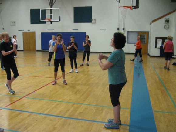Exercise instructor Lisa Laing receives applause from her students