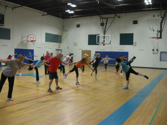 Exercise students, with Lisa, balancing for strength