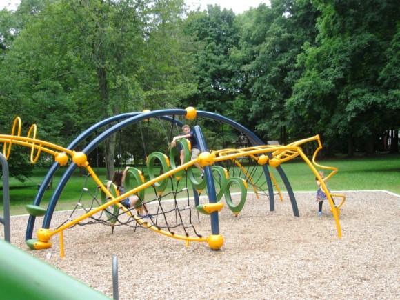 Enjoying new playground equipment in Essex
