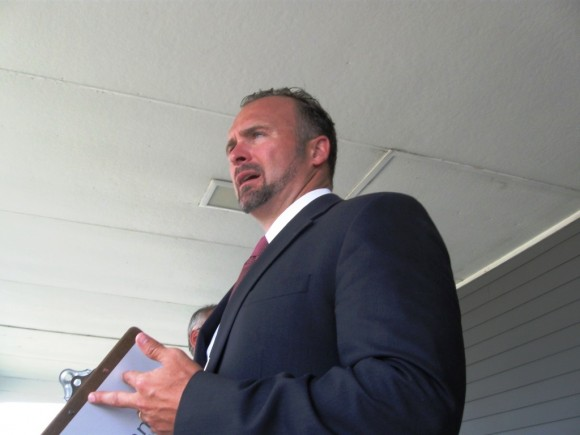 "Justin Manning, who conducted the recent ""Absolute Auction"" at the Essex Island Marina"