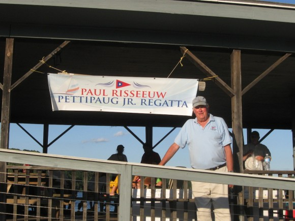 Paul Risseeuw stands next to the banner that marked the recent Junior Sailing Regatta at the Pettipaug Yacht Club