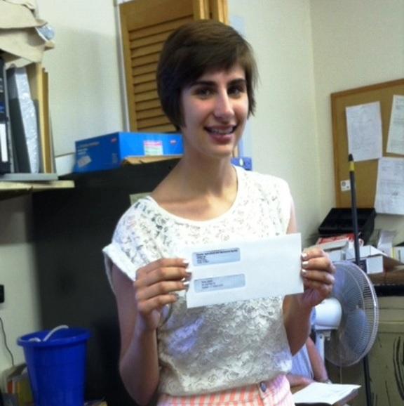 Bailey Baisel receives her scholarship from the Chester Fair.
