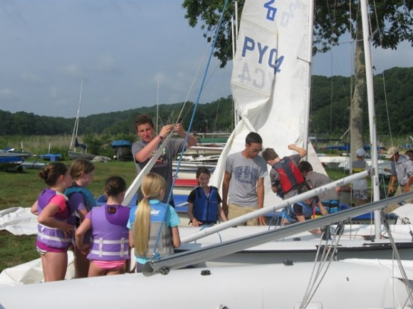 Getting the boats ready to launch with Junior Instructors helping out