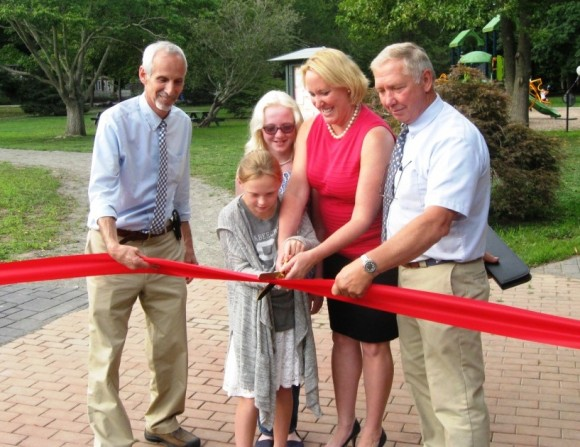 Cutting the ribbon: (l to r) First Selectman Norman Needleman, Ryce Libby, Maizy Libby, Selectman Stacy Libby, Selectman Bruce Glowar (photo by Jerome Wilson)