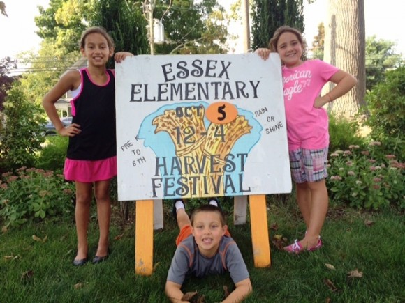 Lilly Glaski, Alexa Clark and Tryon Clark help get the word out about the Essex Elementary Harvest Festival on Sunday October 5th, noon-4:00, rain or shine.