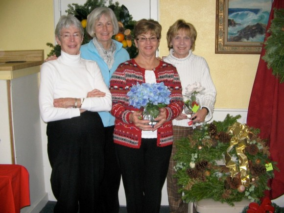 Members of the committee preparing the live wreaths and greenery decor, one of the fair's most popular features, are (left to right) Mellicent Hawke of Essex, Susan Nilsen of Ivoryton, Judy Greene and Lillian Mosa, both of Essex.