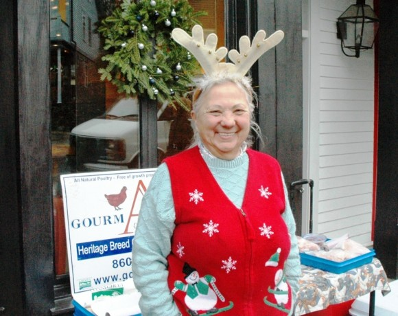 Eleanore Provencal is perfectly dressed for All Hat Day at the Chester Holiday Market as she sells GourmAvian all-natural poultry. She is one of about ten vendors of locally grown and produced foods who will be in Chester for the four weeks of the Holiday Market.